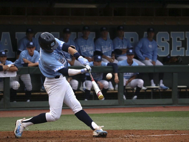North Carolina shortstop Logan Warmoth (7) swings at a pitch against Gardner-Webb on February 22.