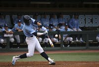 North Carolina shortstop Logan Warmoth (7) swings at a pitch against Gardner-Webb on February 22.