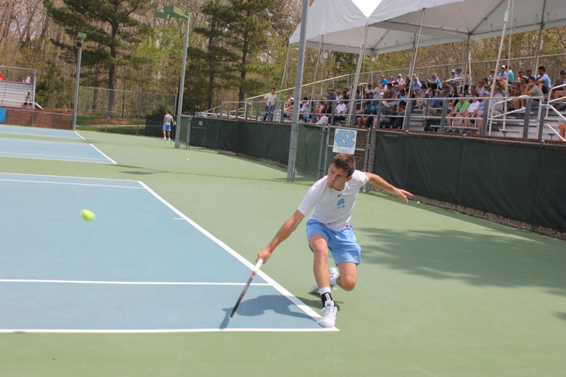 Senior Robert Kelly hits a backhand against Georgia Tech on April 14 at the Cone-Kenfield Tennis Center.