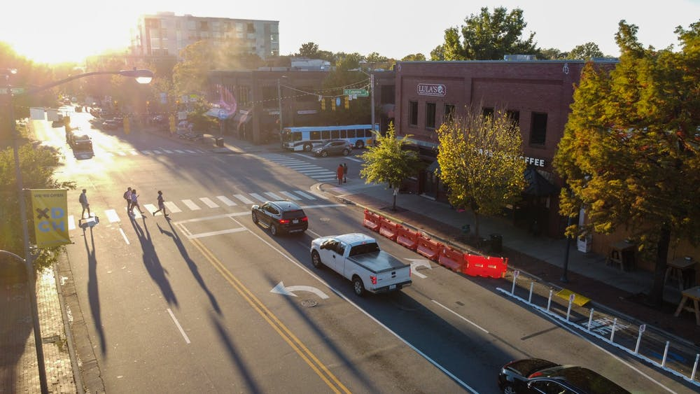 <p>Cars drive down Franklin Street on Monday, Oct. 26, 2020.</p>