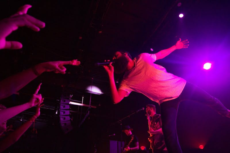 """Melo croons out the lyrics to their hit song """"Seven"""" while extending towards the outstretched hands (both big and small) of the crowd."""