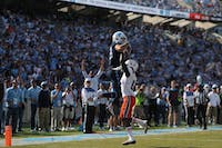 Wide receiver Beau Corrales (88) elevates for a touchdown against Miami on Saturday, Oct. 28, 2018 in Kenan Stadium.