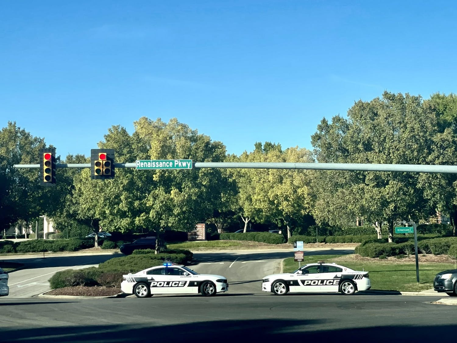 Police cars line Renaissance Parkway, one of the entrance streets of Southpoint Mall in Durham, on Oct. 24 after hearing reports of an incident involving a firearm.