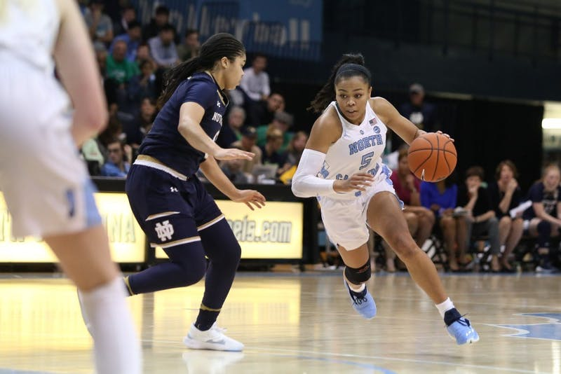 Junior guard Stephanie Watts (5) drives up the court in Carmichael Arena on Sunday, Jan. 27, 2019. UNC defeated Notre Dame 78-73.