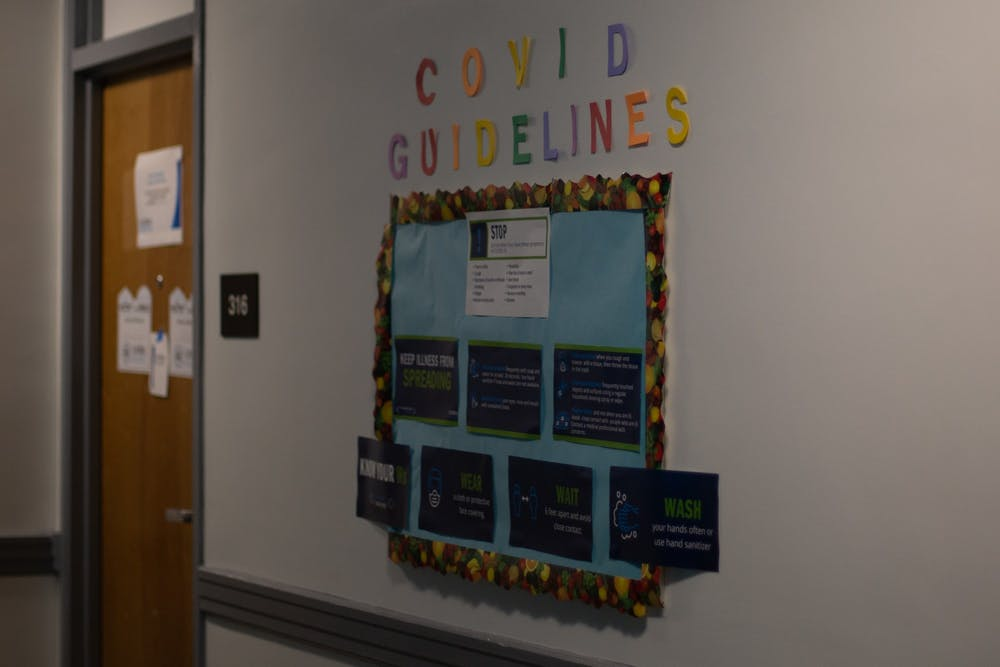 A bulletin board at Joyner Residence Hall details COVID Guidelines.