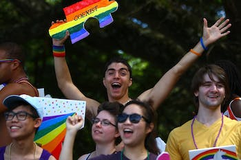 Kyle Kufert, a junior biology major from Charlotte, rides on the UNC LGBTQ Center float at the NC Pride Festival and Parade in Durham on Sept. 27, 2014.