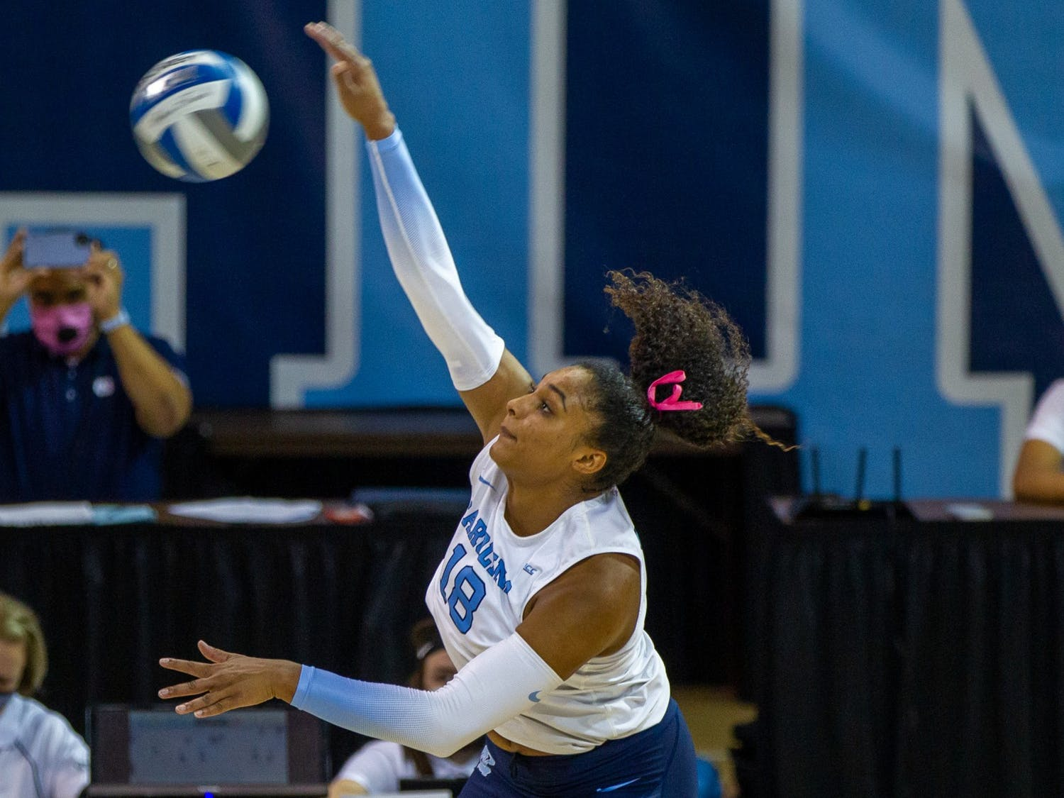 Graduate student outside hitter Nia Robinson (18) hits the ball at the volleyball game against Duke on Oct. 22 at Carmichael Arena. UNC won 3-0.