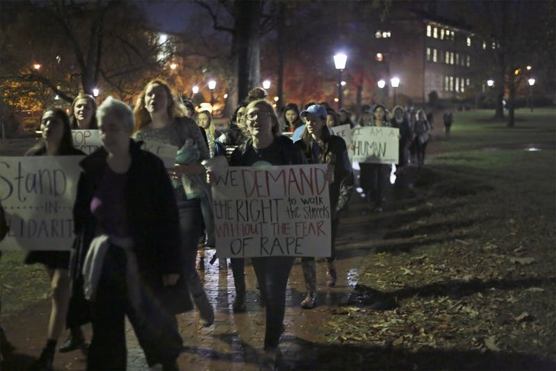 "Women gather to march in ""Take Back the Night,"" a protest against male-patterned violence against women, in 2015."