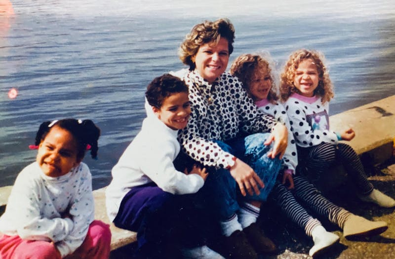 Lynne Burke sits with her children after she was released from prison in 1990. Photo courtesy of Lynne Burke.
