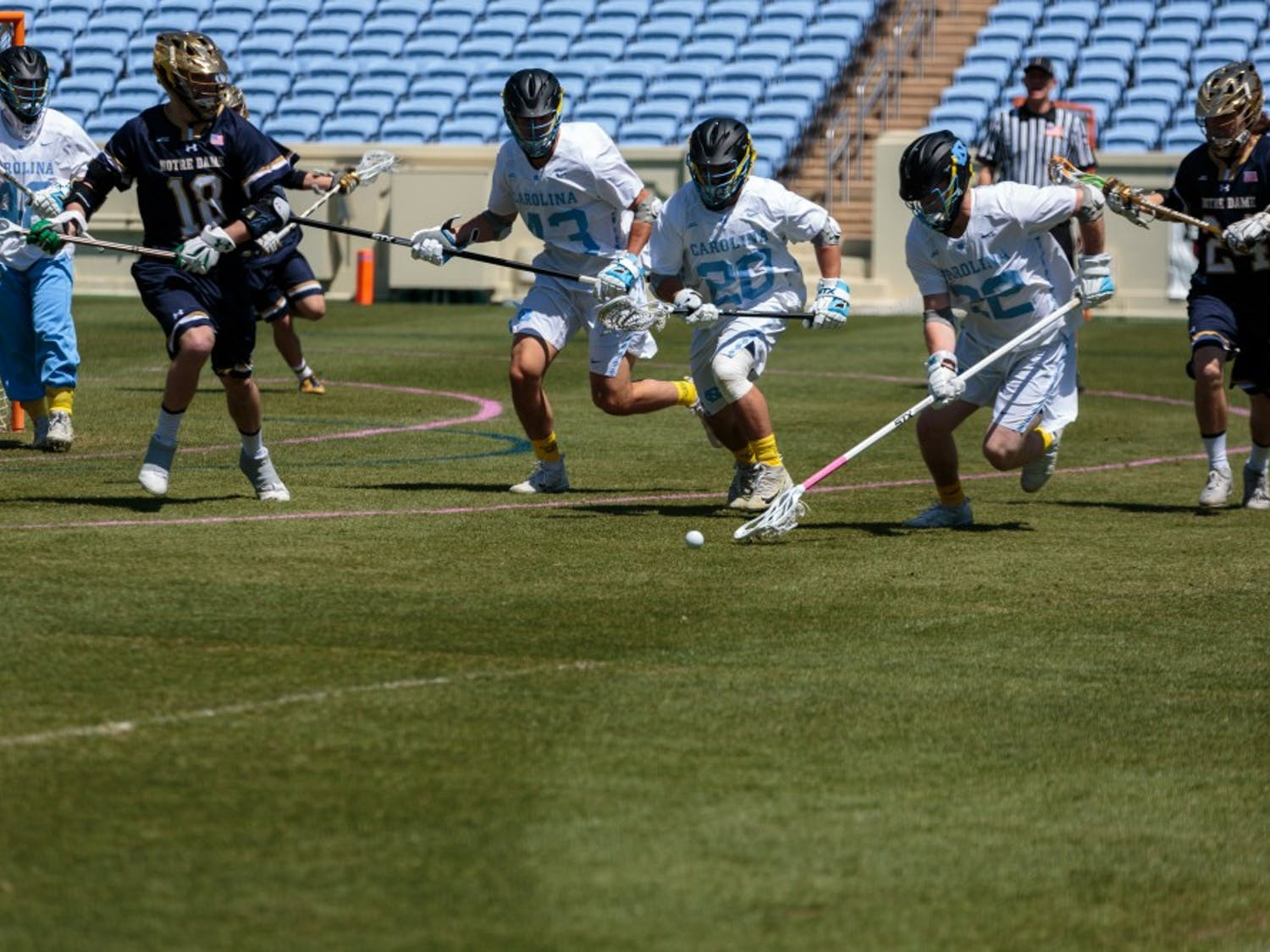 Players on the UNC men's lacrosse team fight for a ground ball against Notre Dame on April 20 at Kenan Stadium.