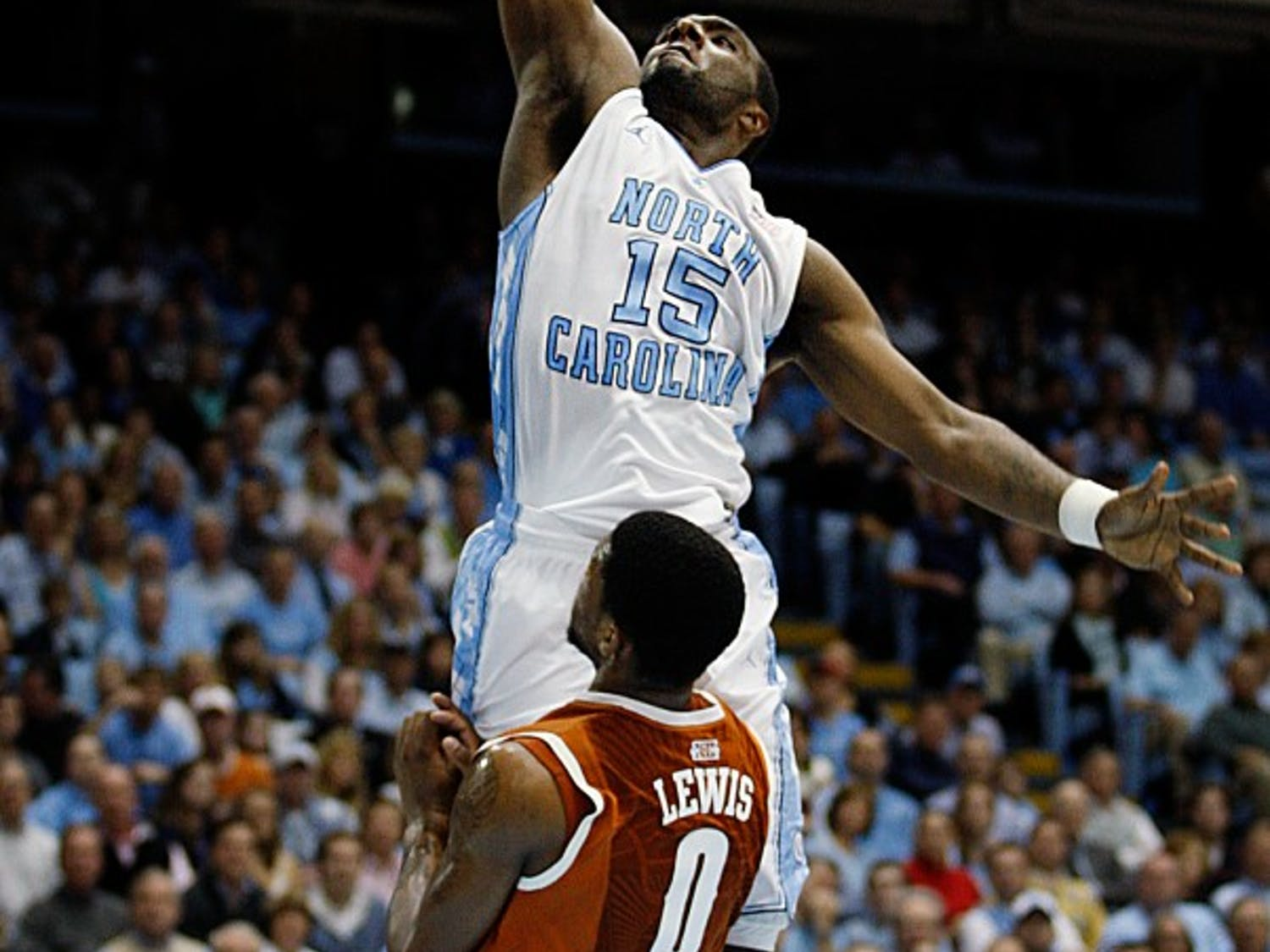 UNC guard P.J. Hairston dunks the ball over Texas guard Julien Lewis during the game Wednesday at the Dean E. Smith Center. Hairston had 5 points in the Tar Heels 82-63 win over Texas.