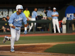 UNC baseball first-year and first basemen, Aaron Sabato (19), runs to first base after hitting the ball during the final game in the regional championships versus Tennessee on Sunday June 2, 2019. UNC won 5-2.