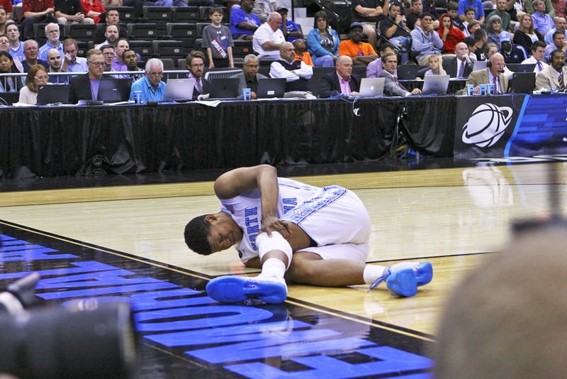 Sophomore forward Kennedy Meeks injures his knee toward the end of the second half during Saturday's win over Arkansas.