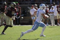 Ryan Switzer (3) makes a break through FSU's defensive line.