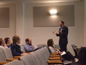 Dylan Russell, president of the Graduate and Professional Student Federation, updates members on their proposed separation from Student Congress on Tuesday in Rosenau Hall at the Gillings School of Global Public Health.