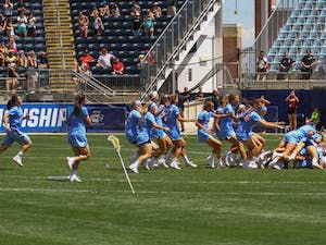 The North Carolina women's lacrosse team swarms goalkeeper Megan Ward afterdefeating Maryland 13-7 to capture the NCAA championship on Sunday at Talen Energy Stadium in Chester, PA.