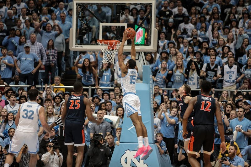UNC sophomore forward Garrison Brooks (15) dunks the ball during the Tar Heels' 69-91 loss against UVA on Monday, Feb. 11, 2019 in the Smith Center in Chapel Hill, NC. Brooks finished the night with 12 points, 8 rebounds and 1 steal for the Tar Heels.