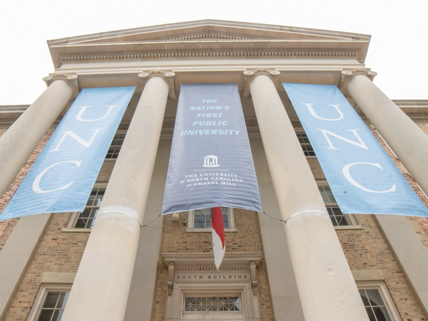 Banners fly on UNC's South Building on Oct. 11, 2021.