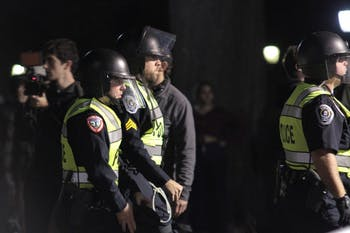 Police officers put on riot gear during the demonstration against the decision to place Silent Sam in a new historic building on campus on Monday, Dec. 3, 2018.