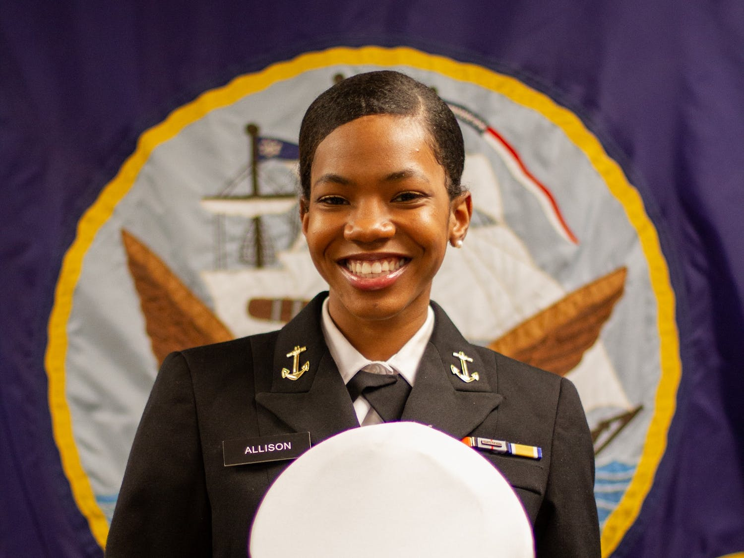 Kenya Allison poses for a portrait at the Naval Armory in Chapel Hill on Monday, Feb. 22, 2021 with her NROTC cap. Allison is the first Black female Battalion Commanding Officer for NROTC.