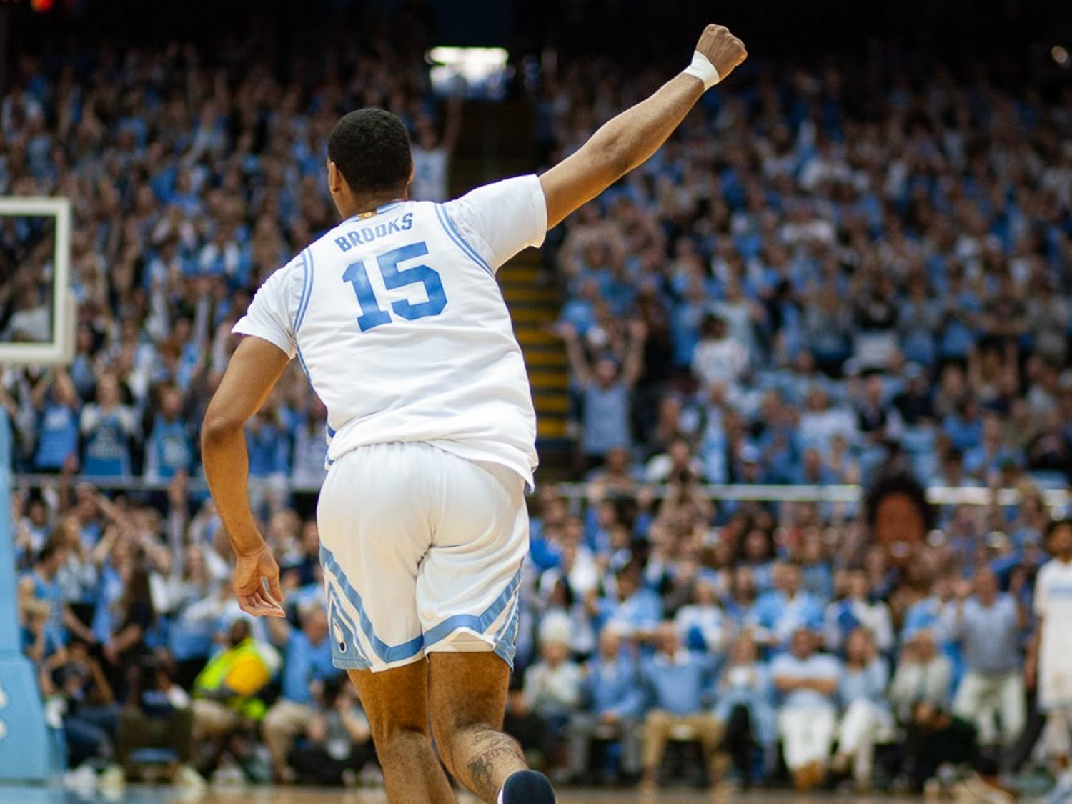 UNC junior forward Garrison Brooks (15) celebrates during a game against N.C. State in the Smith Center on Tuesday, Feb. 25, 2020. UNC defeated State 85-79, snapping the team's seven game losing streak.