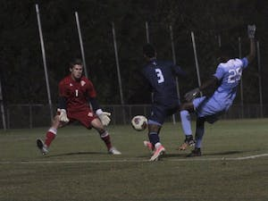 Forward Jelani Pieters (26) takes a shot against UNC-Wilmington on Sunday night at WakeMed Soccer Park in Cary.