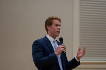 Student body president candidate Reeves Mosely speaks during the SBP debate on Monday, Feb. 10, 2020. The candidates debated civic engagement, graduate student needs, diversity and police conduct, among other topics.