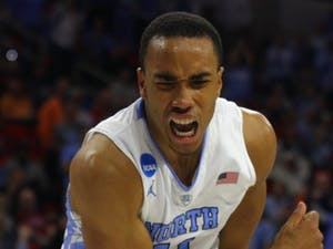 Senior Brice Johnson reacts after scoring during the second half.