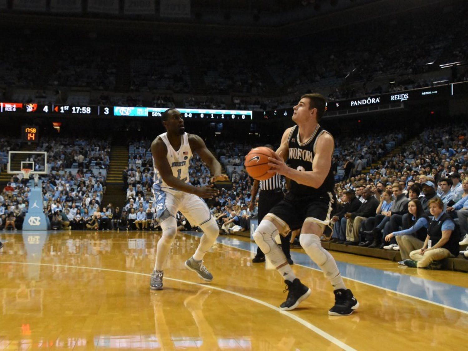 Wofford guard Fletcher Magee (3) prepares to shoot as North Carolina wing Theo Pinson (1) closes in on him during a Dec. 20 game in the Smith Center.