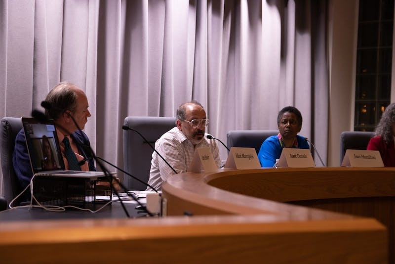 Orange County Commissioners Candidates (from left) Amy Fowler (via laptop), Mark Marcopolos, Mark Dorosin and Jean Hamilton discuss their platforms at the CHCCS PTA Council Orange County Commissioners Candidate Forum at Chapel Hill Town Hall on Monday, Feb. 3, 2020.