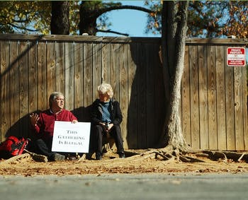 Stephen Dear and Maria Darlington have lunch on the corner of Jones Ferry and Davie Roads in Carrboro in protest of the anti-lingering ordinance.  Stephen has spent his lunch break during the week on this corner since the last week in October and is joined by friends and supporters daily.