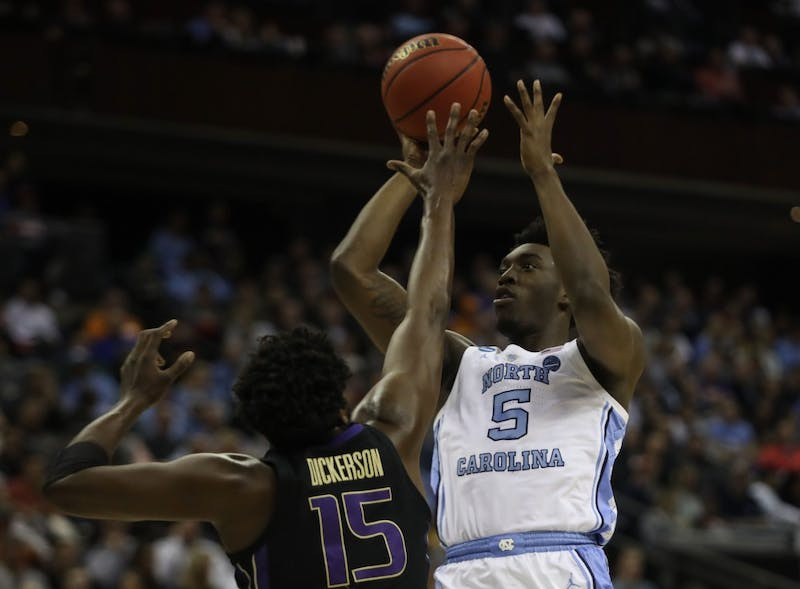 Washington forward Noah Dickerson (15) attempts to block a shot by UNC first-year guard Nassir Little (5) in the second round of the NCAA tournament at Nationwide Arena in Columbus, OH on Sunday, March 24, 2019. UNC defeated Washington 81-59. Little scored 20 points for the Tar Heels.