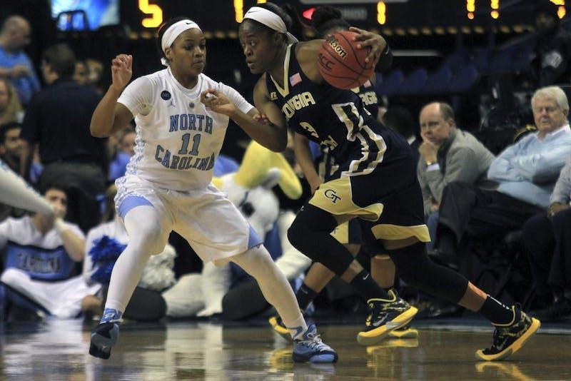 Brittany Rountree (11) attempts to guard Georgia Tech guard Kaela Davis (3).