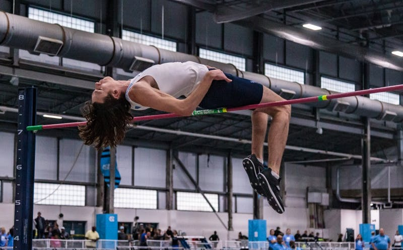 Redshirt junior Draven Crist competes in the high jump event at the Dick Taylor Carolina Cup in the Eddie Smith Field House on Saturday, Jan. 12 2019.