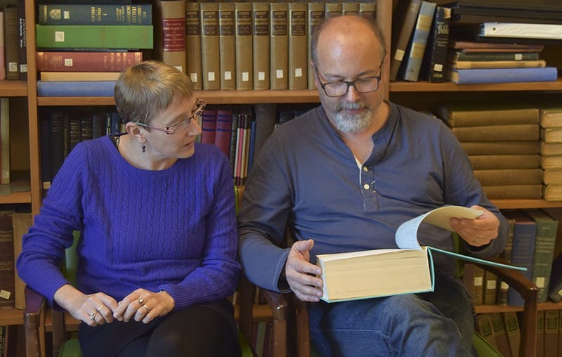 Jessica Wolfe (Director of Comparative LiteratureProfessor, English and Comparative Literature) and Reid Barbour (Professor of English) look over the first half of Reid's thesis that he wrote in 1982.