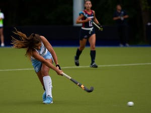 Senior midfielder Eva Smolenaars (21) bats the ball during UNC's field hockey game against Liberty University on Sunday, Oct. 10, 2021, in Chapel Hill, N.C. Liberty won that game 4-0.
