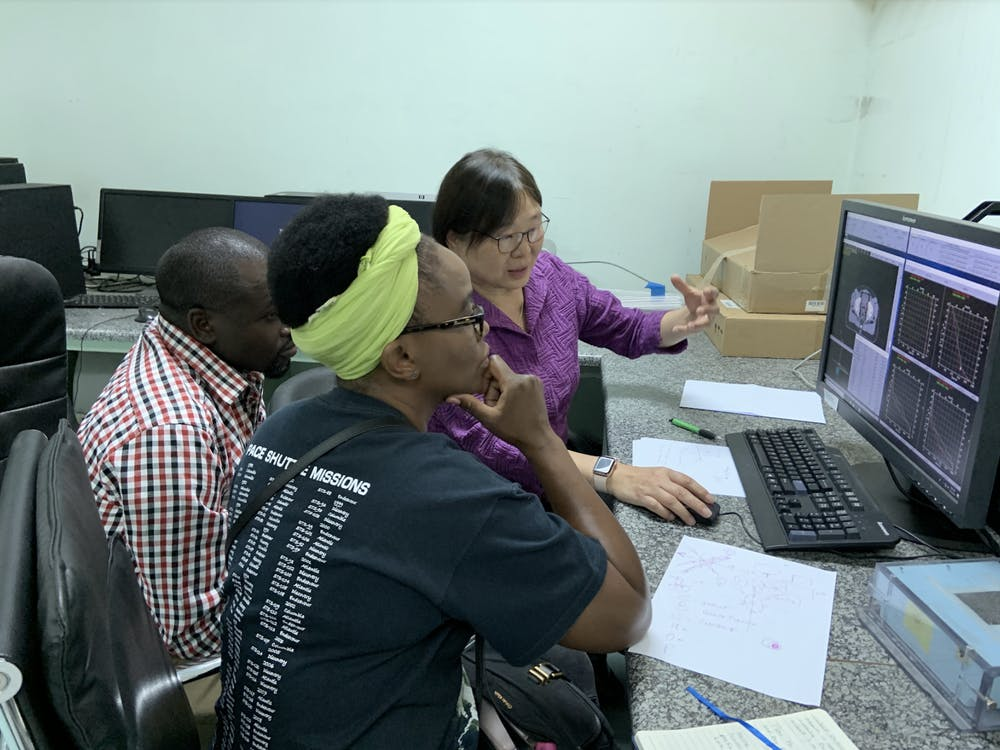 <p>Sha Chang, founder of EmpowerRT, teaches physicians at the Cancer Diseases Hospital in Zambia how to use EmpowerRT's software. The software will enable the Hospital to improve its radiation treatment. Photo courtesy of Sha Chang.</p>