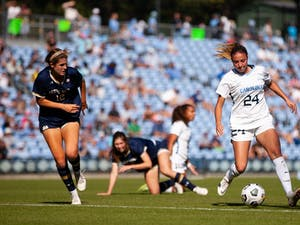 UNC sophomore midfielder Talia Dellaperuta (24) drives the ball down the field against Notre Dame on Oct. 24. The Tar Heels defeated the Fighting Irish 2-1 in overtime.