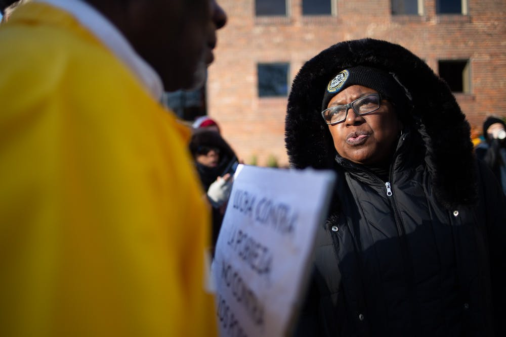 Anna Richards, president of the Chapel Hill-Carrboro NAACP, speaks to an attendee at the Peace and Justice Plaza during a Martin Luther King Jr. rally sponsored by Chapel Hill-Carrboro NAACP's Youth Council on Monday, Jan. 20, 2020. Hundreds of members of the community gathered to consider King's legacy in Chapel Hill and beyond.