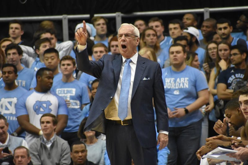 Men's basketball head coach Roy Williams yells from the sideline against Michigan on Nov. 29 in the Smith Center.