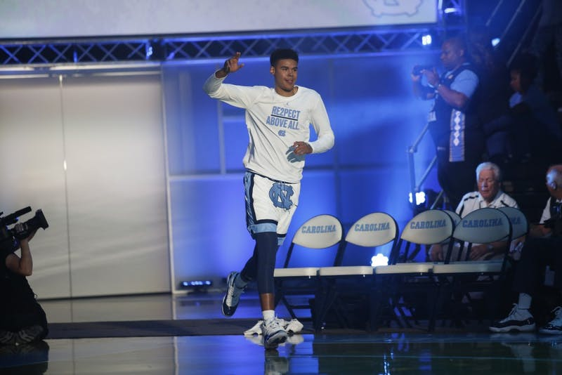 Guard Cam Johnson runs out of the tunnel during UNC's Late Night With Roy event on Oct. 13.