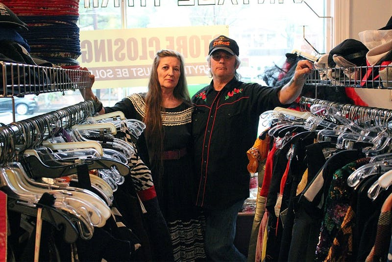 Ann Jackson (left) and Steven Schrenzel, owners of the vintage thrift shop Time after Time, locked the doors to the store for the last time Tuesday.