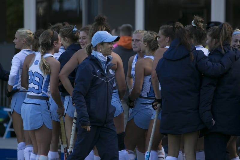Head coach Karen Shelton celebrates with the UNC field hockey team after a 5-2 win against Michigan during the second round of the NCAA Tournament Sunday, Nov. 11, 2018 in Karen Shelton Stadium.
