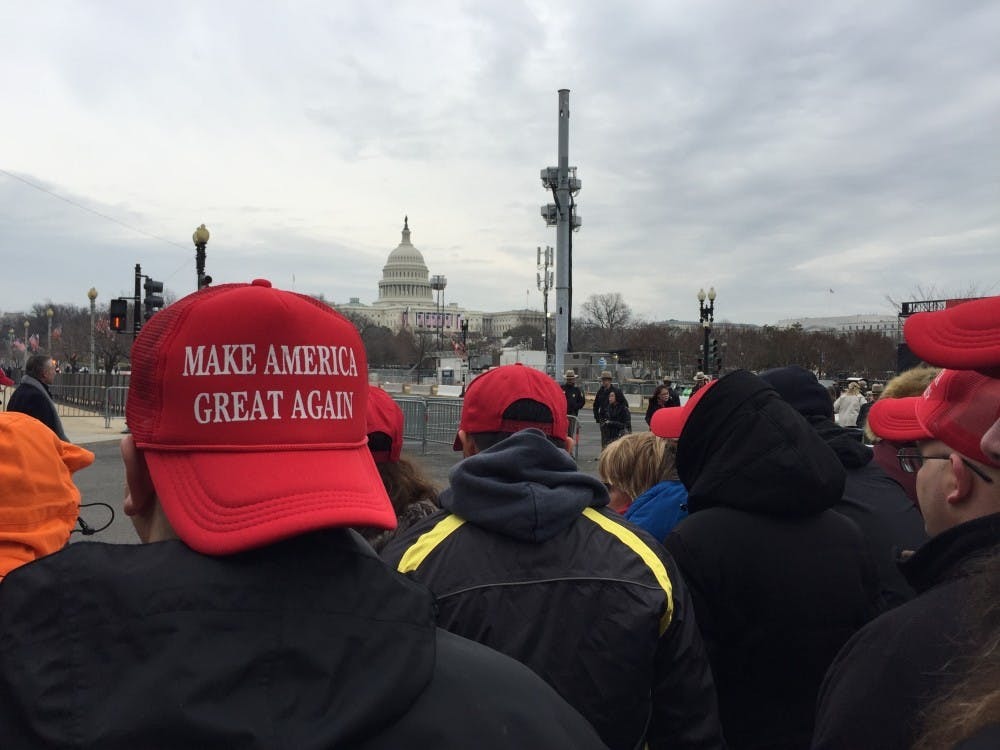 """<p>Trump supporters don """"Make America Great Again"""" hats in the moments leading up to the president's inauguration.&nbsp;</p>"""