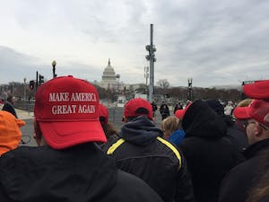 "Trump supporters don ""Make America Great Again"" hats in the moments leading up to the president's inauguration."