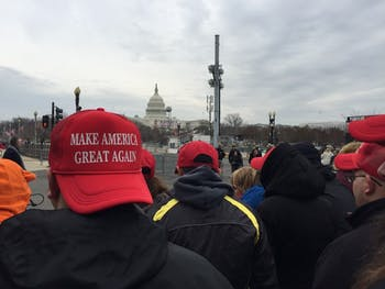 """Trump supporters don """"Make America Great Again"""" hats in the moments leading up to the president's inauguration."""