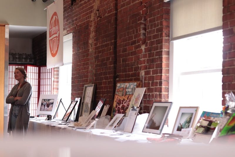 The Art Therapy Institute's annual fundraiser includes a silent auction of art donated from clients and local artists. Photo courtesy of Hillary Rubesin.