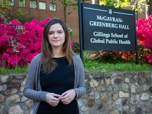 """Anna Berrier, a senior health policy management major and president of the medical fraternity Alpha Epsilon Delta, poses for a portrait at the Gillings School of Public Health on Tuesday, April 23, 2019. Berrier agrees with the Kaplan survey that suggests medical school and the medical profession should increase diversity. She views policies like affirmative action as """"leveling the playing field."""""""