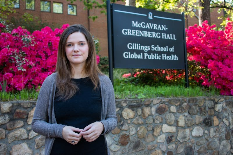"Anna Berrier, a senior health policy management major and president of the medical fraternity Alpha Epsilon Delta, poses for a portrait at the Gillings School of Public Health on Tuesday, April 23, 2019. Berrier agrees with the Kaplan survey that suggests medical school and the medical profession should increase diversity. She views policies like affirmative action as ""leveling the playing field."""