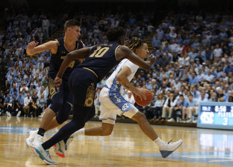 UNC guard Cole Anthony drives past Notre Dame defenders on Wednesday, Nov. 6, 2019 in the Dean E. Smith Center. The Tar Heels beat the Fighting Irish 76-65.